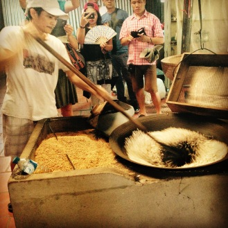 Rice popcorn being made by hand.